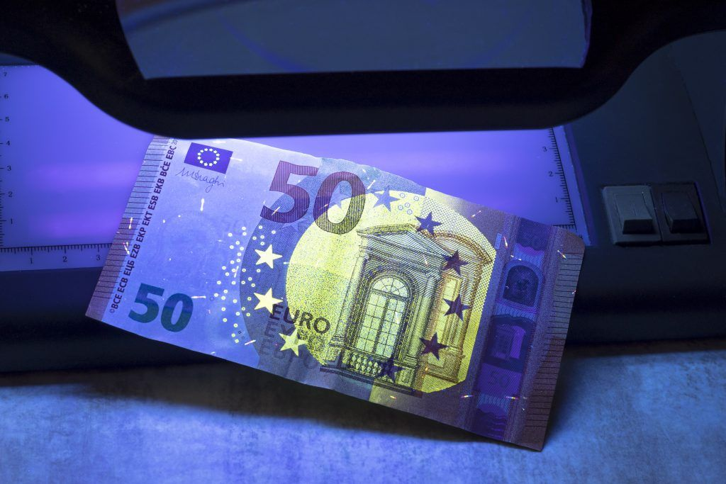 50 Euro Banknote Being Examined